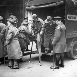 Wounded soldiers descending from an ambulance