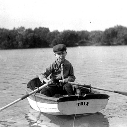 "Jack Searcy as a small boy in a rowing boat, ""Trix"", April 1907"