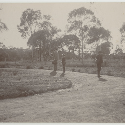 Edwin Ashby with his sons in Wittunga farm's front garden