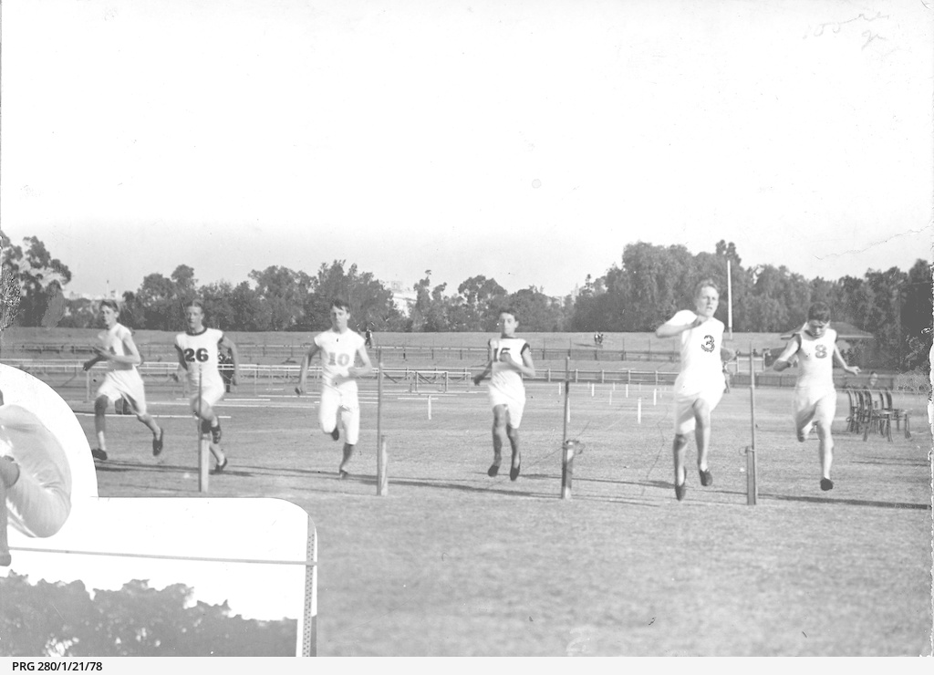 Men running in a track and field event in South Australia