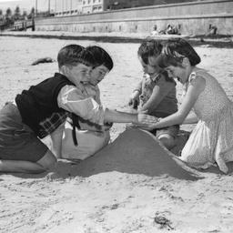 Children building a sandcastle