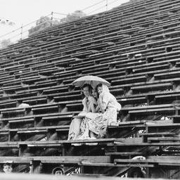 Lone spectators in a grandstand