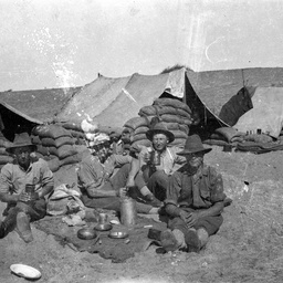Soldiers eating.