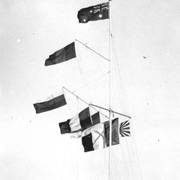 Flags flying from a masthead