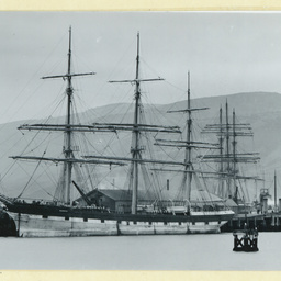 The 'Blenheim' docked near a rocky outcropping