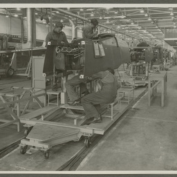 Employees working on aircraft fuselages.