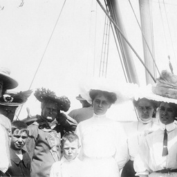 A group of adults, including Miss Violet Searcy, and children on board the S.S. Governor Musgrave'