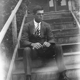 Young man sitting on some steps