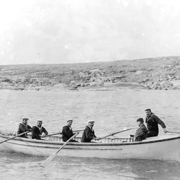 A team of sailors rowing the President of the Marine Board, Arthur Searcy, for landing at Neptune Island