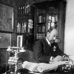 Arthur Searcy, Commissioner of Taxes and Stamps working in his office