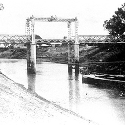 Wilcannia Bridge on the Darling with a barge in low river