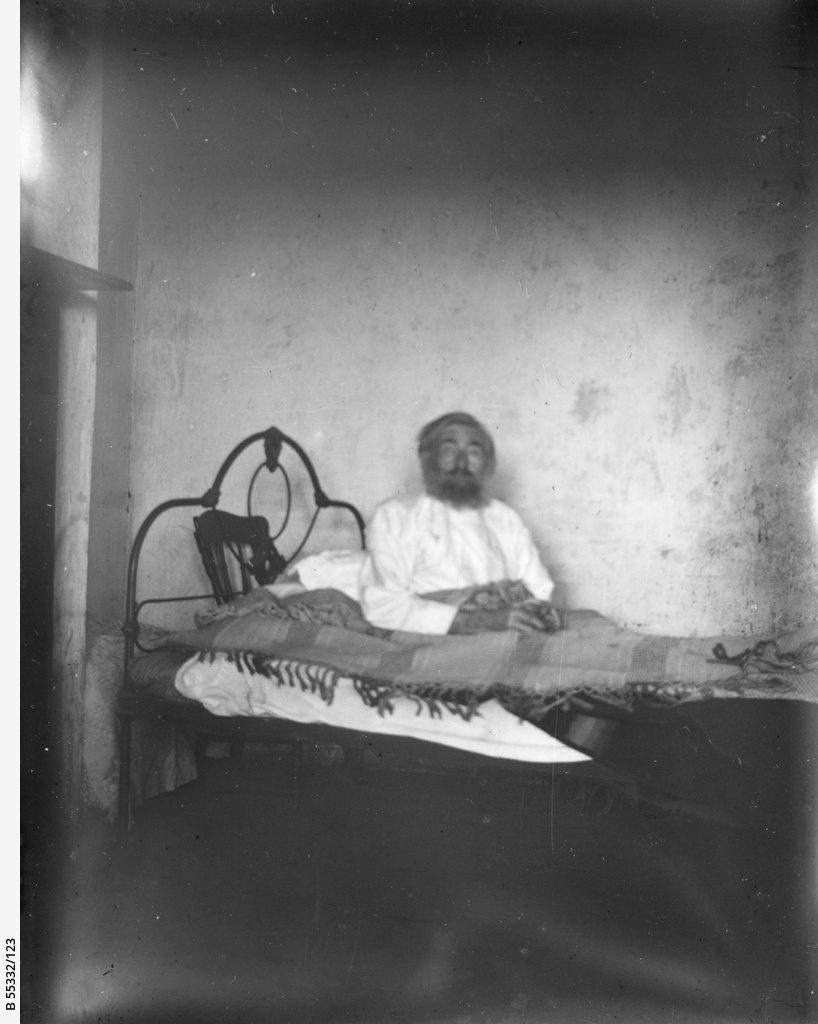 Man sitting in a bed