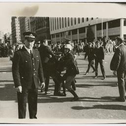 Policemen wrestling a protester at the Vietnam War Moratorium rally