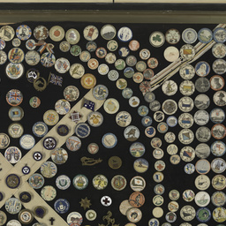 Framed collection of World War I badges
