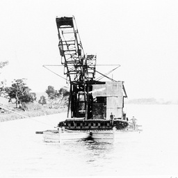 Transporting an excavator on barges near Murray Bridge