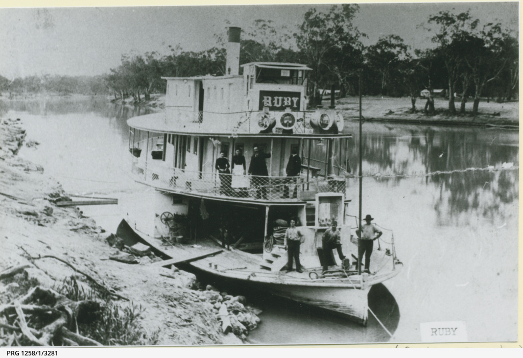 The old P.S. Ruby at river bank with crew including women