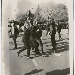 Policemen detaining a protester at the Vietnam War Moratorium rally
