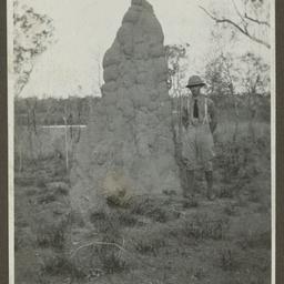 Keith Smith by a termite mound.