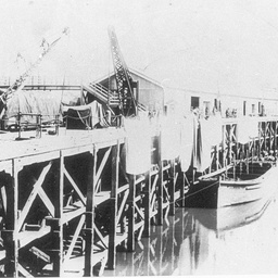 Echuca wharf with large squares possibly canvas overhanging to dry
