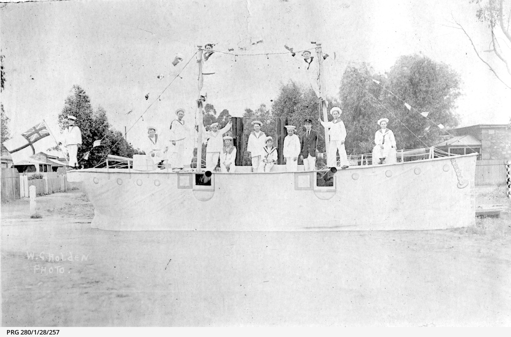 Children dressed as sailors on a pageant float