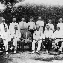 A group of Parliamentary officers dressed for cricket