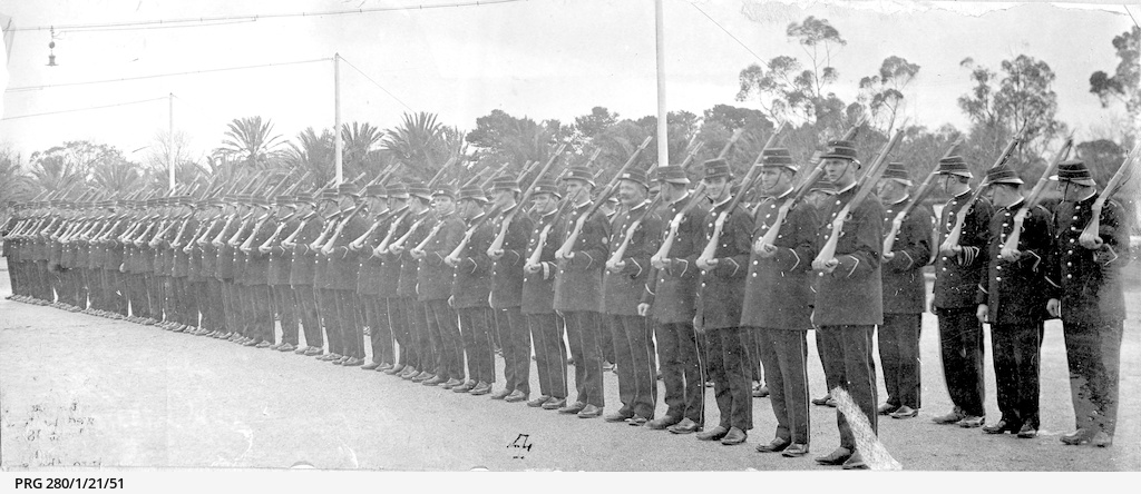 South Australian police standing to attention with sloped arms