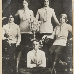Women rowers with a trophy