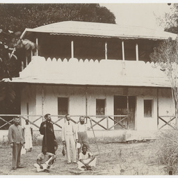 Group outside two storey house