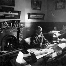 Arthur Searcy sitting at his office desk
