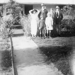 Family group in front of a cottage