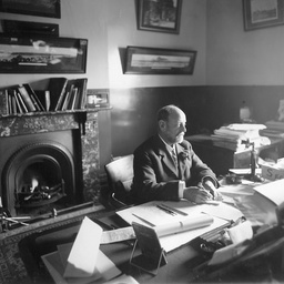 Arthur Searcy sitting at an office desk