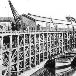 Echuca Wharf showing its structure, with two barges tied up