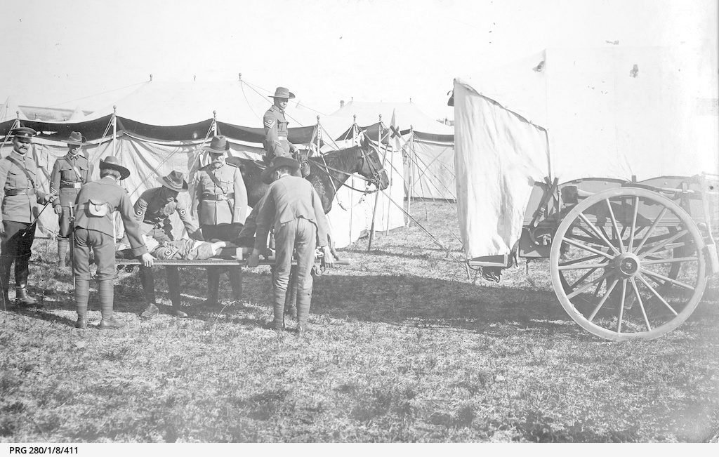 Men of the Army Medical Corps demonstrating stretcher at camp