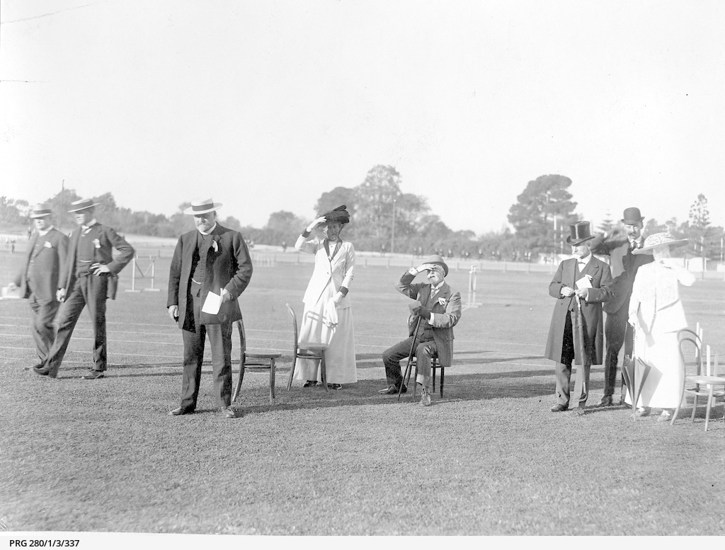 A group of guests watching events at a Sports Day