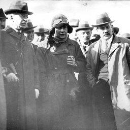 Captain Harry Butler standing with a group of men