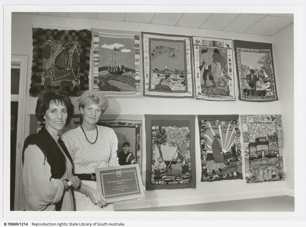 North Adelaide Primary School teachers Jan Raftery and Evelynne Richardson with the set of historic wallhangings that students stitched, darned and glued to create a colourful collection showing 12 stages in Australian history. 5th October 1988.