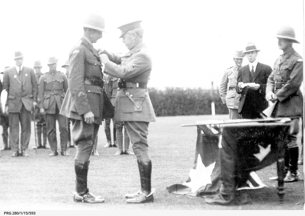Sir Henry Galway presenting the D.S.O. to Colonel S. Price Weir