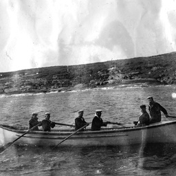 A naval rowing boat taking A. Searcy to land on Neptune Island