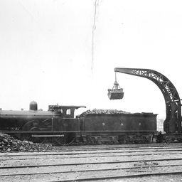 Steam crane loading coal on to a railway truck