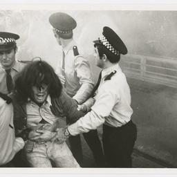 Anti Vietnam War demonstrator being dragged to police van