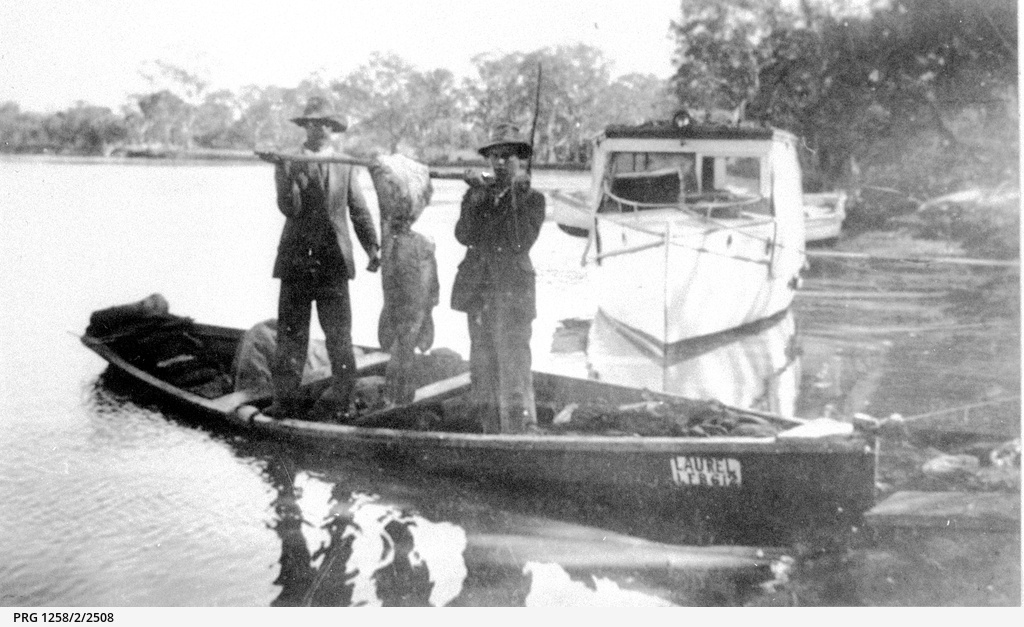 Two fishermen holding a large cod caught on the lower River Murray