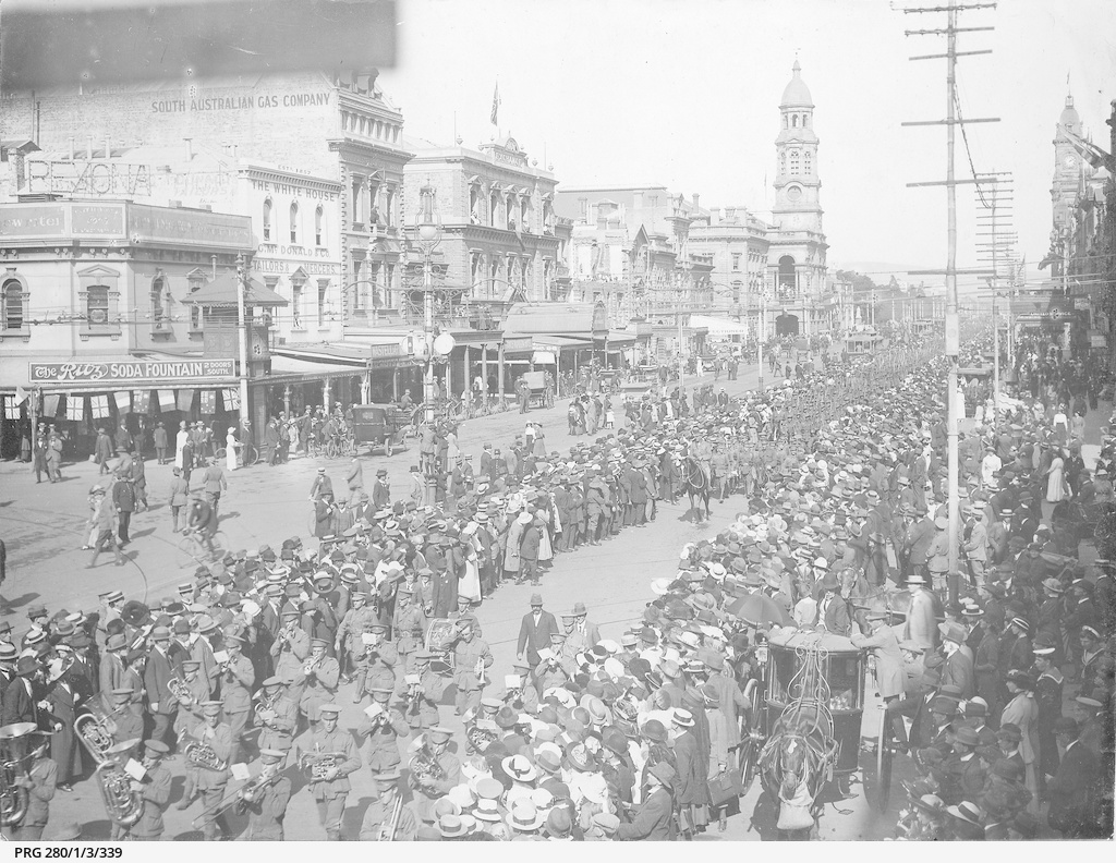 A military band leading South Australian soldiers as they make a farewell march along King William Street