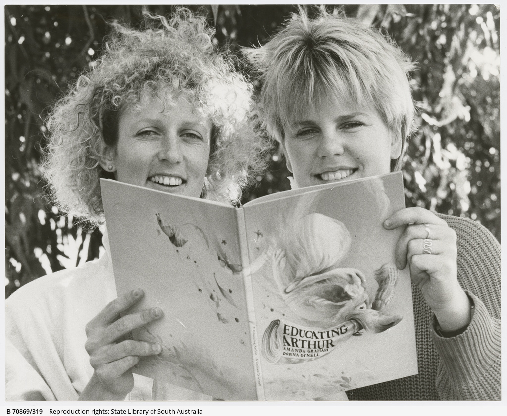 Blackwood author manda Graham (right) reads through 'Educating Arthur' with artist Donna Gynell of Parkside. 27 May 1987.