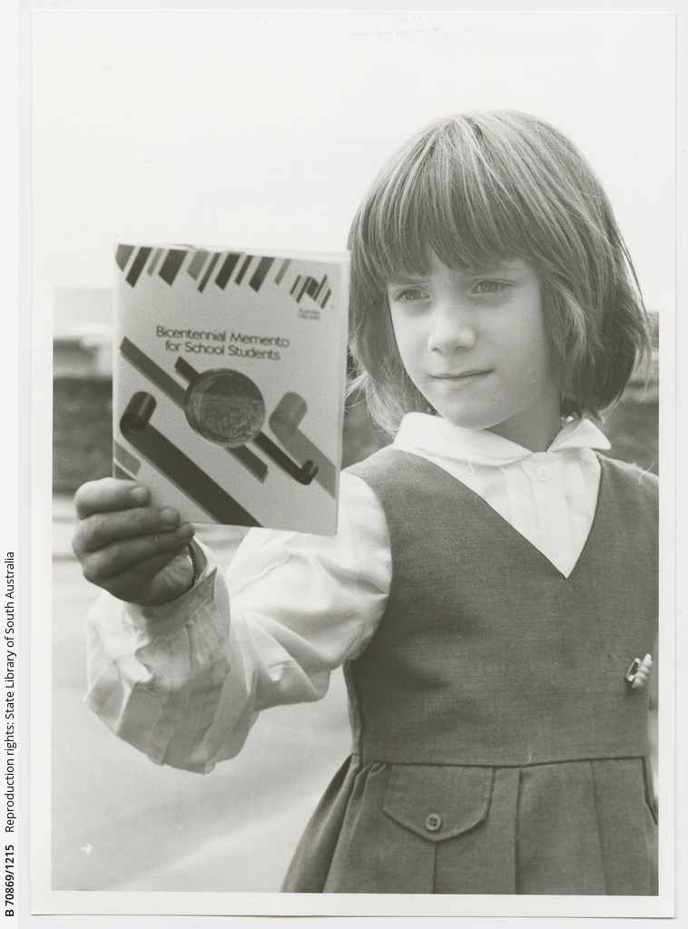 North Adelaide Primary School student Elenor (6), reading about the Bicentennary.1988.