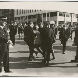 Police detaining a protester at the Vietnam War Moratorium rally