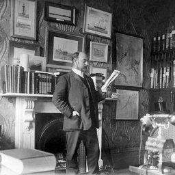 Arthur Searcy reading a document in his office at Victoria Square, Adelaide