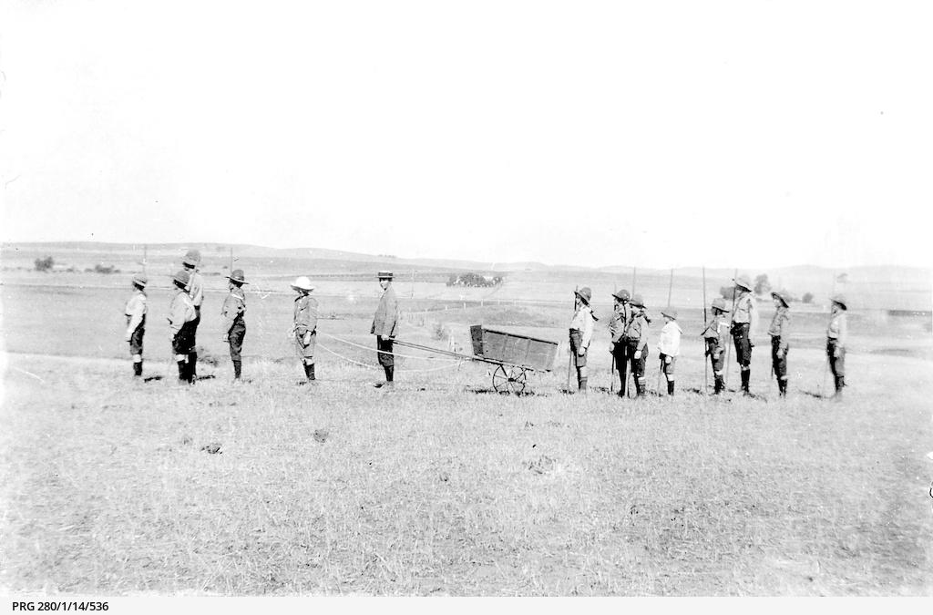 Boy Scout recruits with a trek cart