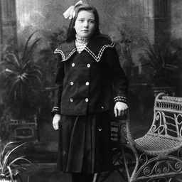 Young girl wearing a double breasted suit