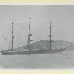 The 'Argomene' anchored nearly a hilly coastline