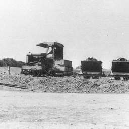Jervois Embankment 1929 with tractor train hauling small trucks